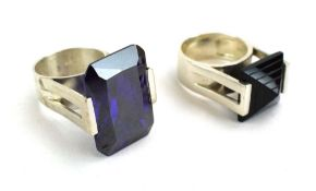 A late 20th century silver dress ring of imposing proportions set vivid purple glass in a raised