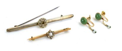 A late 19th century yellow metal bar brooch set old cut diamond within a border of six small