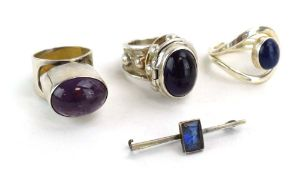 A late 20th century silver 'poison' ring set cabochon amethyst, maker PGW, London 1991,