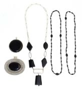 A late 20th century metalware pendant of oversized proportions centrally set with oval black