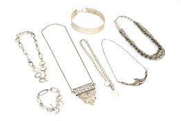 Six late 20th century silver and metalware necklaces including a hammered metalware choker,