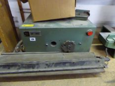 FAG Model CE-600 bench top cutting machine with small circular blade and travelling table