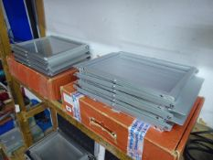 Two folding exhibition leaflet stands in cardboard boxes