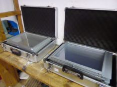 Two folding exhibition leaflet stands in aluminium flight cases