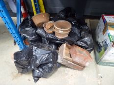 Large quantity of bagged and unbagged terracotta pots