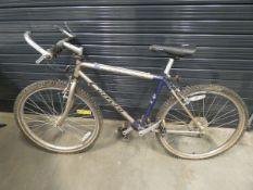 Carrera gold and blue gents mountain bike