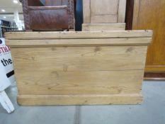 A stripped pine blanket box