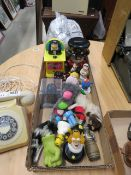 A box containing Simpson, Mr Men and other ornamental figures, plus a money box and toys
