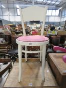A white painted Thonet-style cafe chair