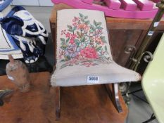A floral embroidered gout stool