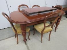 Edwardian mahogany extending dining table together with six balloon back chairs (set of 4 plus two