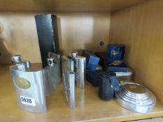 A quantity of hip flasks and letter openers