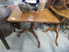 A Victorian tripod side table