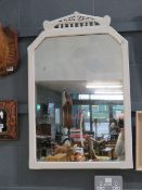 A mirror in white painted frame