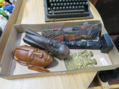 A box containing 5 African and Central American figures