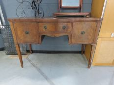 A mahogany serpentine fronted sideboard