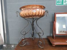 A hammered copper Victorian bowl with wrought iron stand, plus a stainless steel mixing bowl