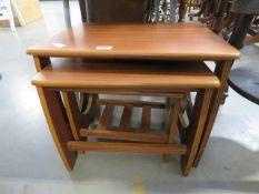 333 - A nest of 3 teak tables