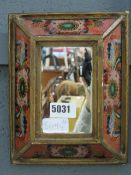 (24) A small ornamental chinoiserie mirror in coloured glass frame