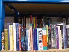 Shelf of selection of hardback and paperback novels, autobiographies etc