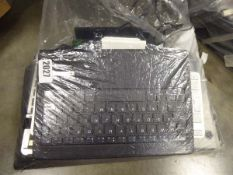 Bag of various laptop adaptor batteries, mobile phones for spares/repairs and tablet docks