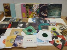Selection of various titled LP & 45 rpm records including Deep Purple,. The Beatles, Commadors,