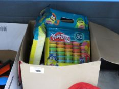 Box containing Play Doh and other mixed toys