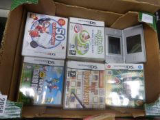 Nintendo DS in silver with various games including Super Mario Brothers
