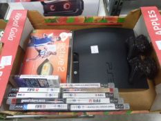 Playstation 3 console with 2 spare controllers and various games including Grand Theft Auto 4
