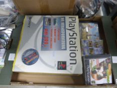 Cardboard tray containing Playstation 1 console, boxed