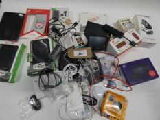 Bag containing tablet/phone cases, cables, TomTom GPS, BT 4G Assure, TomTom mount, bluetooth
