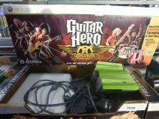 X Box 360 console with a selection of games, power supply, Guitar Hero Aerosmith box set