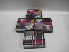 3 full boxes of Pringle socks for ladies together with a part box of ladies Pringle socks (some