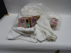 Bag of white hand towels together with a small quantity of Erase Your Face re-usable make-up