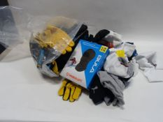 Bag containing working gloves, socks, balaclavas, sun hat, etc