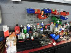 The remaining loose items on the work bench including parts, bulbs, washers ,lubricants, lin bins,