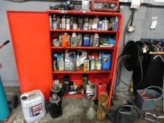 Red 2 door metal cabinet with contents of part used oils and lubricants, 2 motors, old battery
