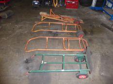 Sack barrow, 2 folding barrows, 2 Champion folding frames and a post hole digger