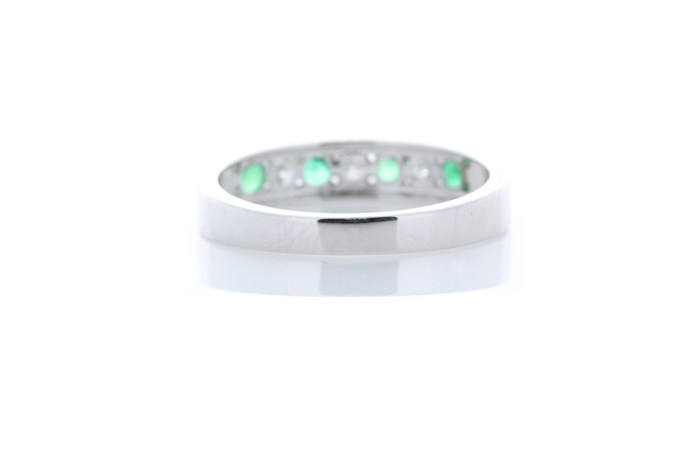 Lot 47 - 9ct White Gold Channel Set Semi Eternity Diamond And Emerald Ring 0.25 Carats