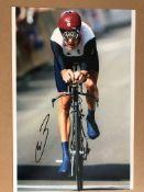 4 sporting photos signed, genuine signature.