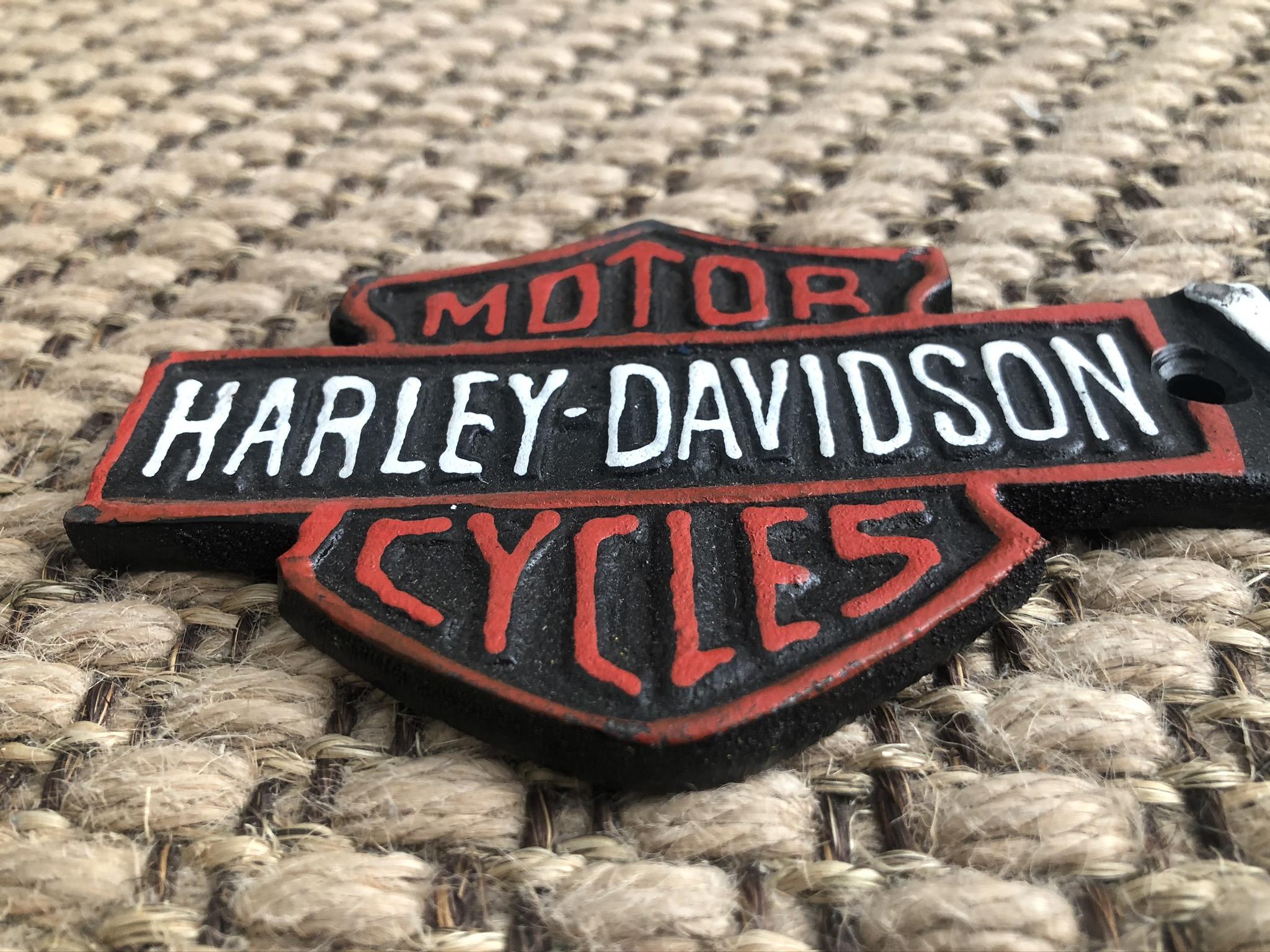 Lot 41 - Cast Iron Harley Davidson Motorcycles Garage Arrow Wall Plaque