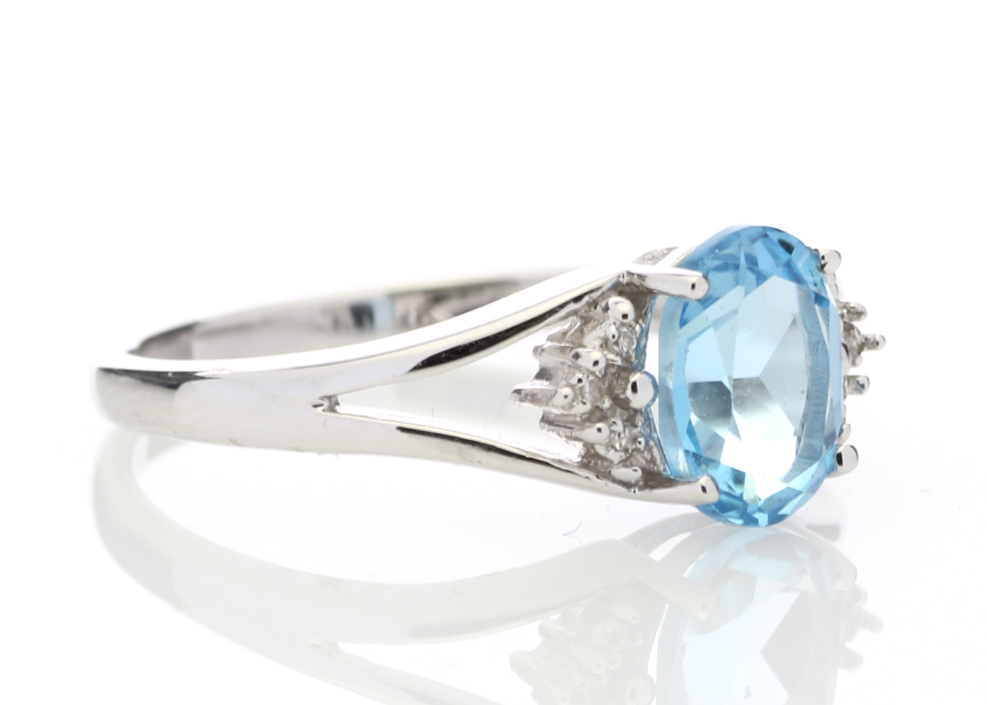 Lot 53 - 9ct White Gold Diamond And Blue Topaz Ring
