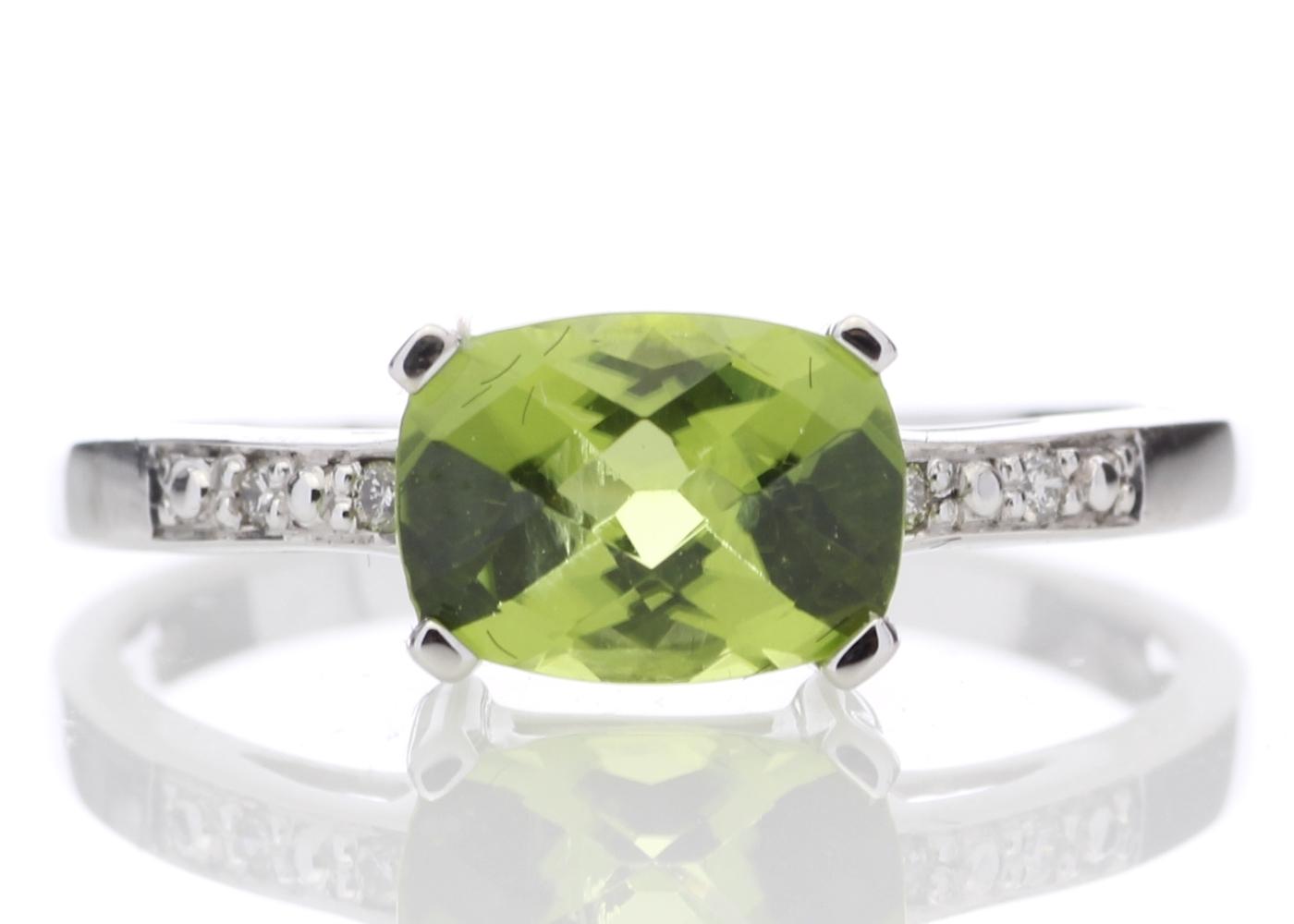 Lot 58 - 9ct White Gold Peridot Diamond Ring
