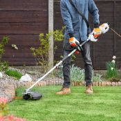 (JH33) Grass Trimmer & Brush Cutter 2-in-1 tool includes a grass trimmer for neatening edges a...