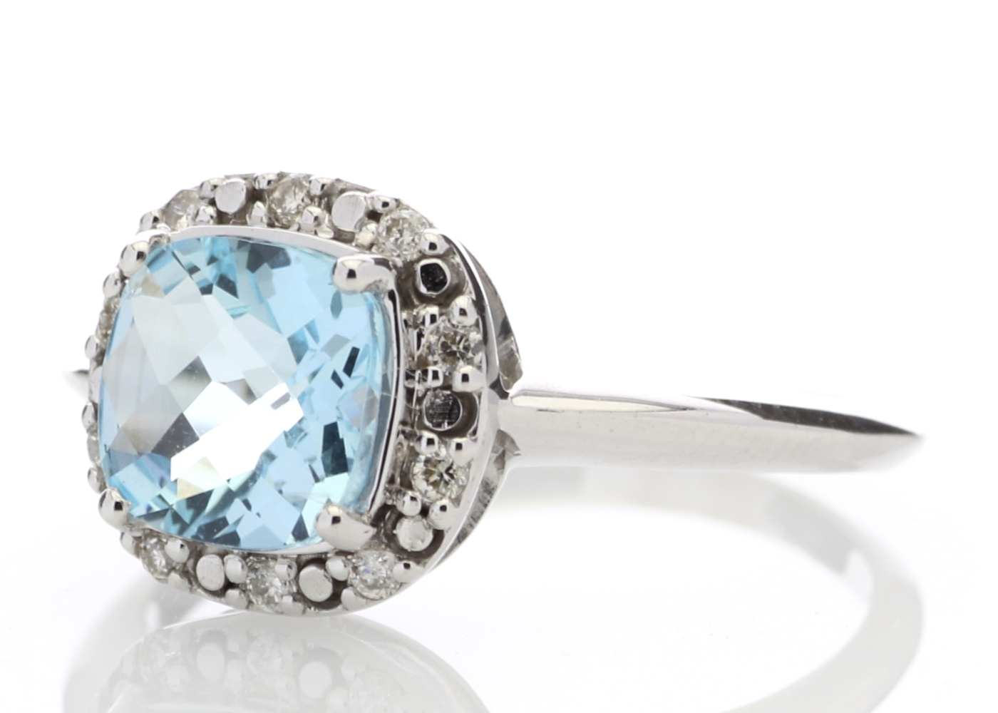 Lot 56 - 9ct White Gold Diamond And Blue Topaz Ring