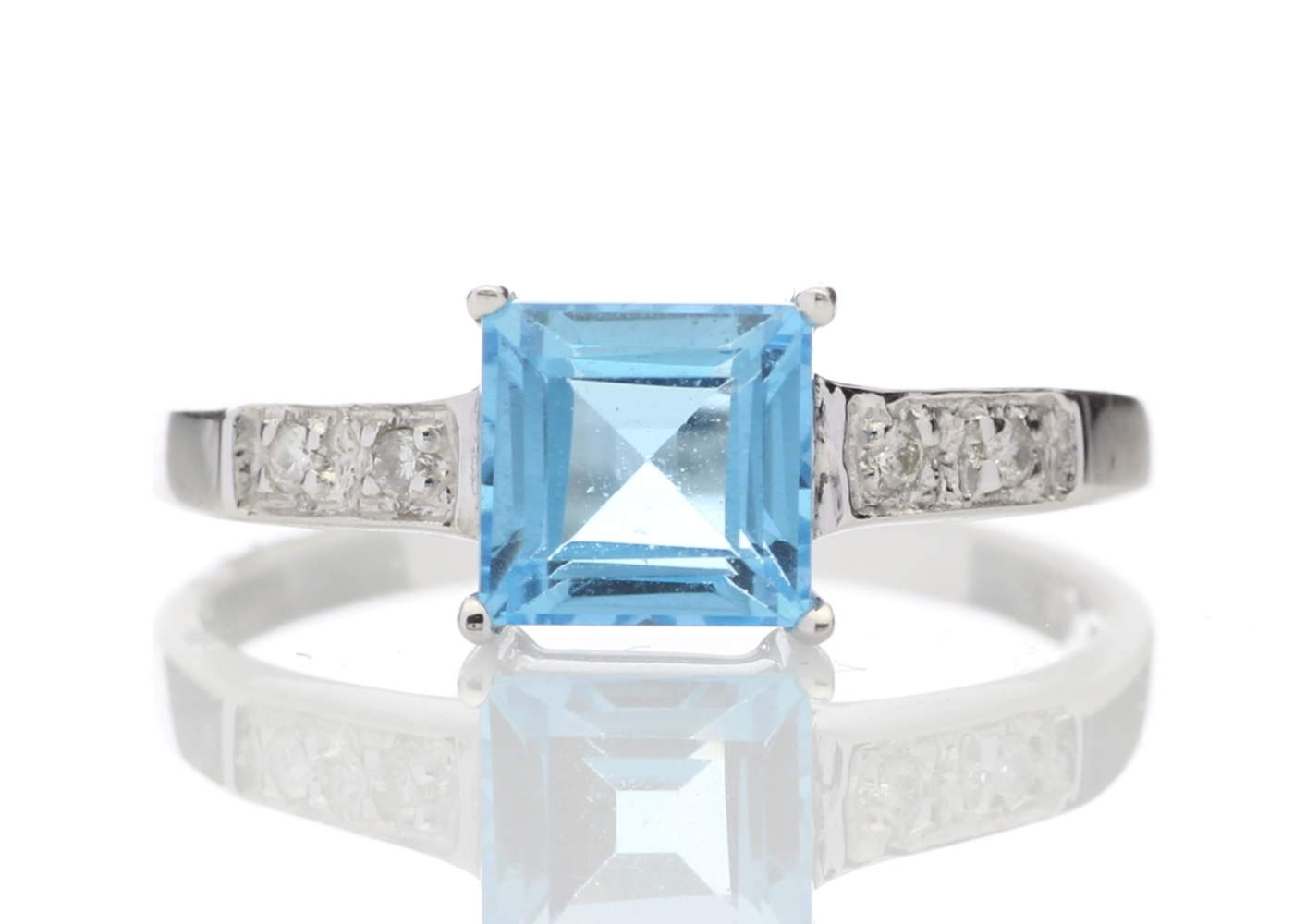 Lot 58 - 9ct White Gold Diamond And Blue Topaz Ring