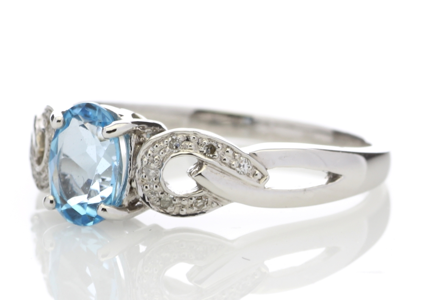 Lot 59 - 9ct White Gold Diamond And Blue Topaz Ring