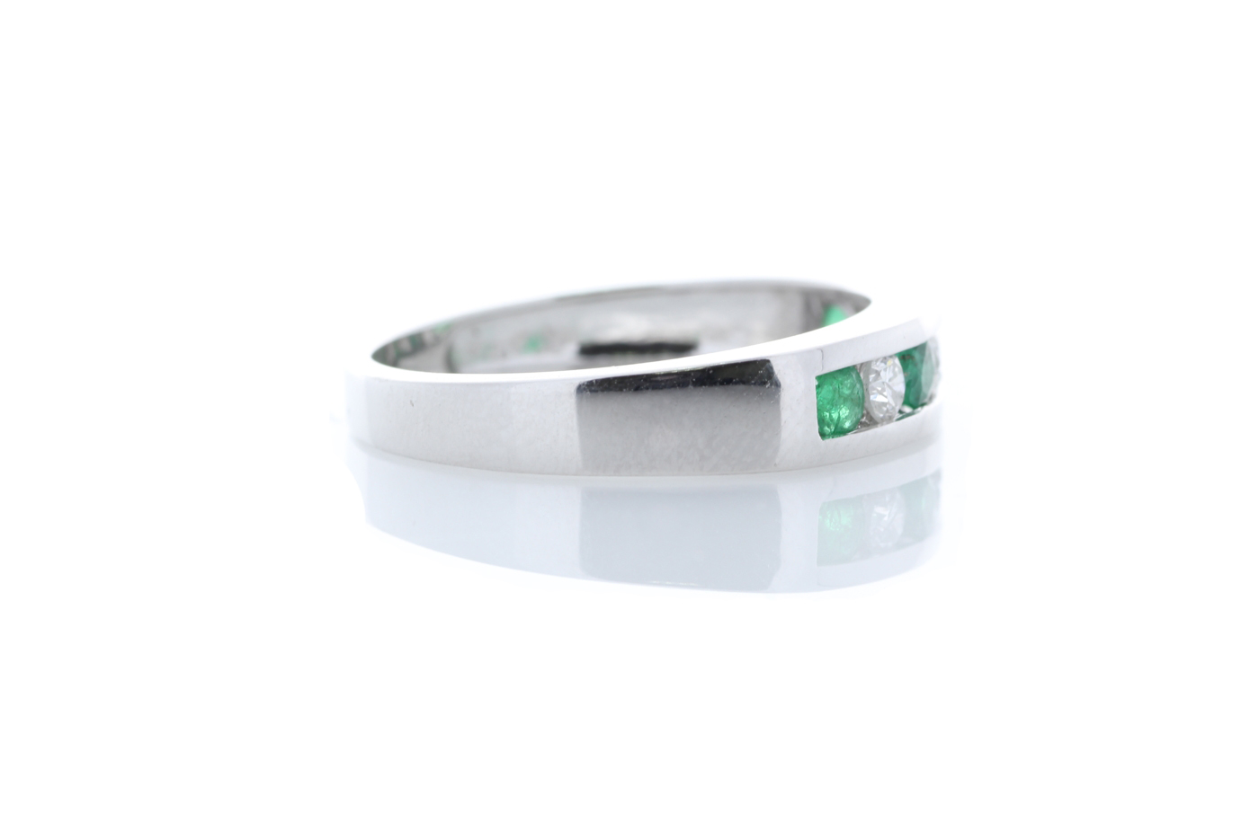 Lot 53 - 9ct White Gold Channel Set Semi Eternity Diamond And Emerald Ring 0.25 Carats