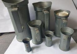 Set Of 7 Pewter Measuring Jugs