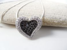 Heart shaped silver pendant on chain